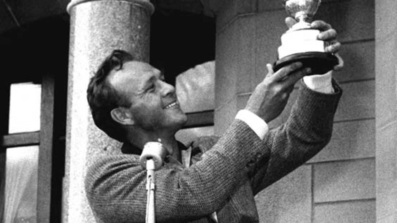 In this July 13, 1952, file photo, British Open champion Arnold Palmer poses with his Claret Jug.AP