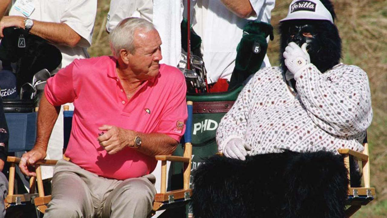 Arnold Palmer takes a puzzled look at a man in a monkey suit seated next to him on the 18th green during the Fred Meyer Challenge golf tournament at Oregon Golf Club in 1997.ASSOCIATED PRESS