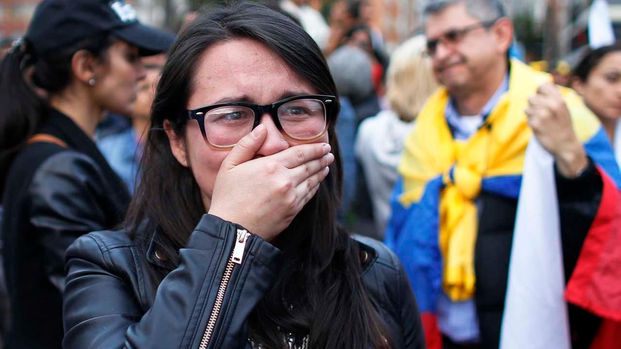 A supporter of the peace accord signed between the Colombian government and rebels of the Revolutionary Armed Forces of Colombia, FARC, cries.AP