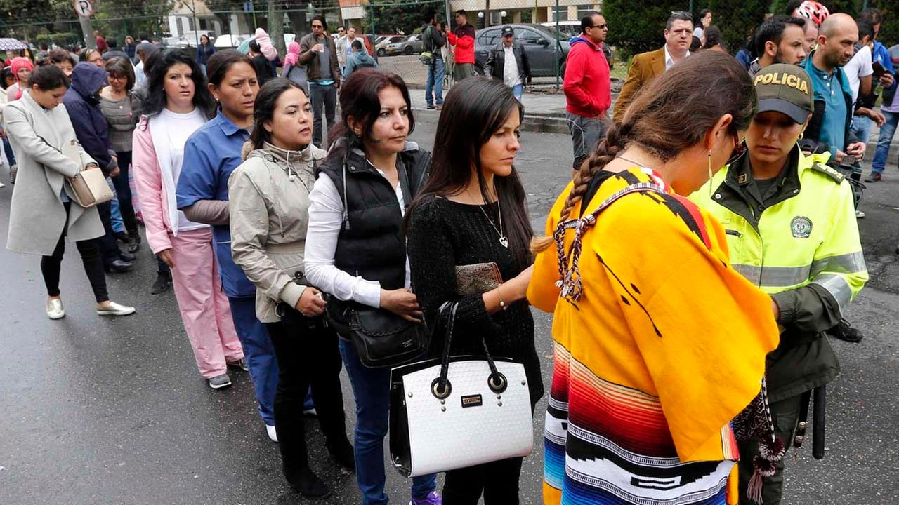 Women line up outside a polling station during a referendum to decide whether or not to support a peace deal signed between the Colombian government and rebels.AP