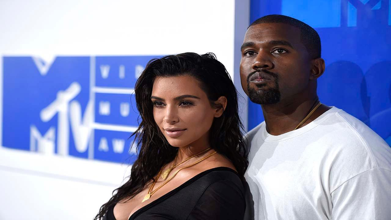 FILE - In this Aug. 28, 2016 file photo, Kim Kardashian West, left, and Kanye West arrive at the MTV Video Music Awards in New York.AP