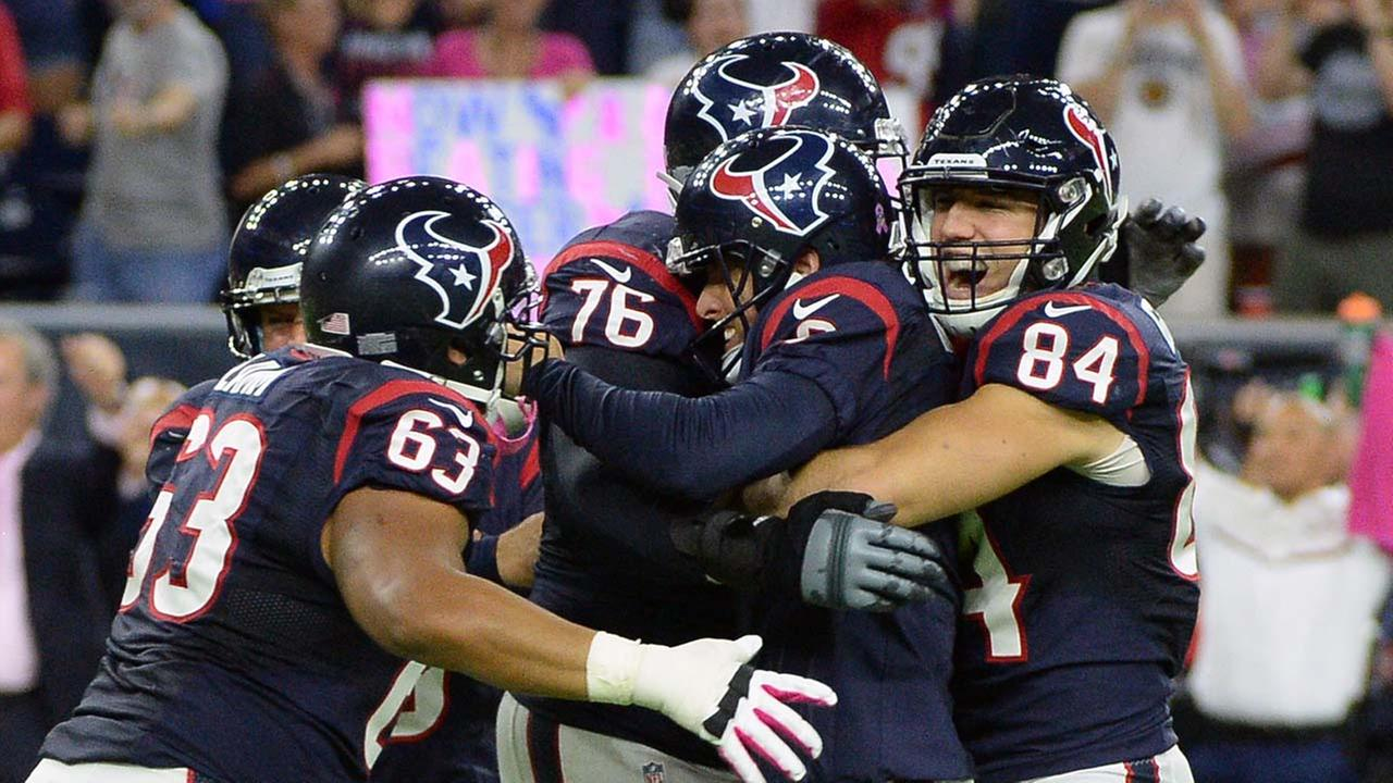 Houston Texans kicker Nick Novak, center, celebrates with teammates after he kicked a 33-yard field goal during overtime of an NFL football game against the Indianapolis Colts