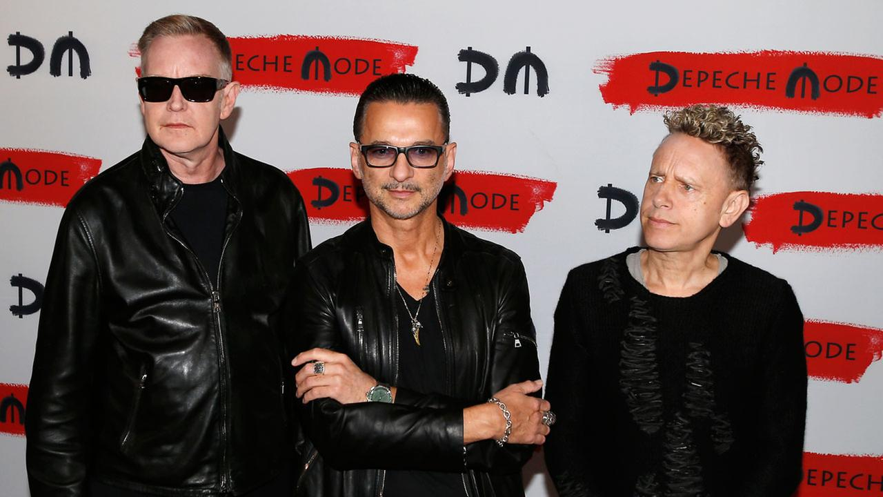From left, Andrew Fletcher, Dave Gahan and Martin Gore, of the British band Depeche Mode, pose for photographers prior to the start of a press conference.AP Photo/Antonio Calanni