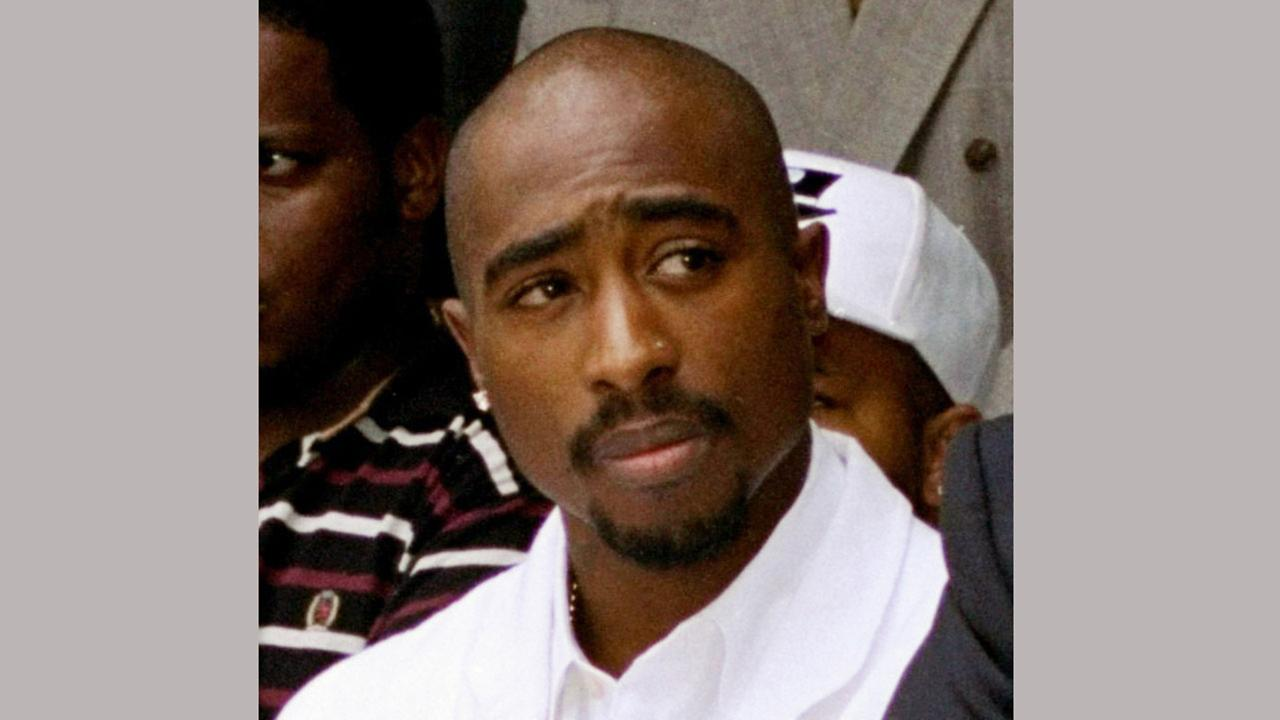 In this Aug. 15, 1996, file photo, rapper Tupac Shakur attends a voter registration event in South Central Los Angeles.AP Photo/Frank Wiese, File
