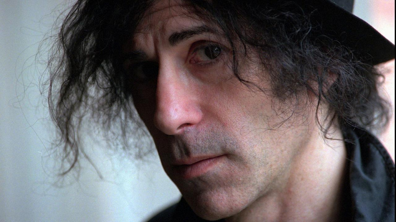 FILE--Veteran rocker Peter Wolf, formerly the lead signer with J. Geils Band, poses after an interview at the Four Seasons Hotel in Boston, May 28, 1996. AP Photo/Jay Malonson,File