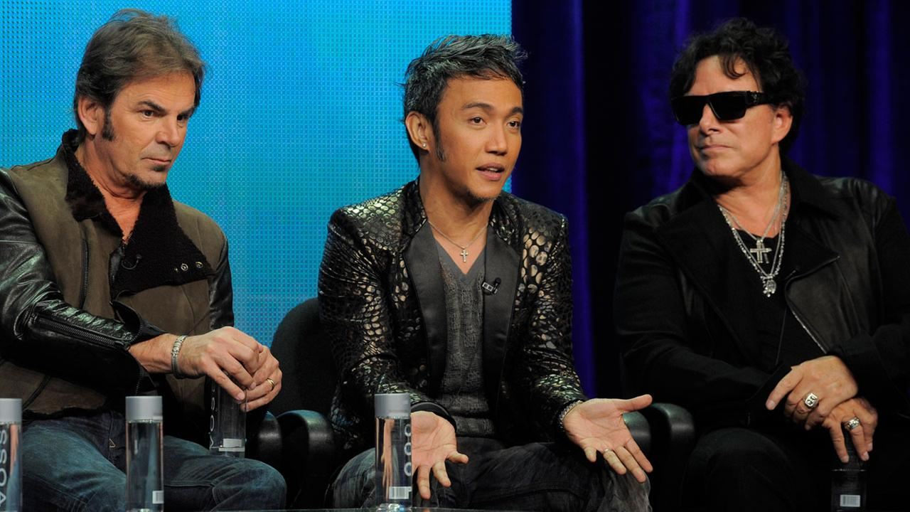 This Aug. 6, 2013 file photo shows members of the band Journey, from left, Jonathan Cain, Arnel Pineda, and Neal Schon during a panel discussion.Chris Pizzello/Invision/AP, File