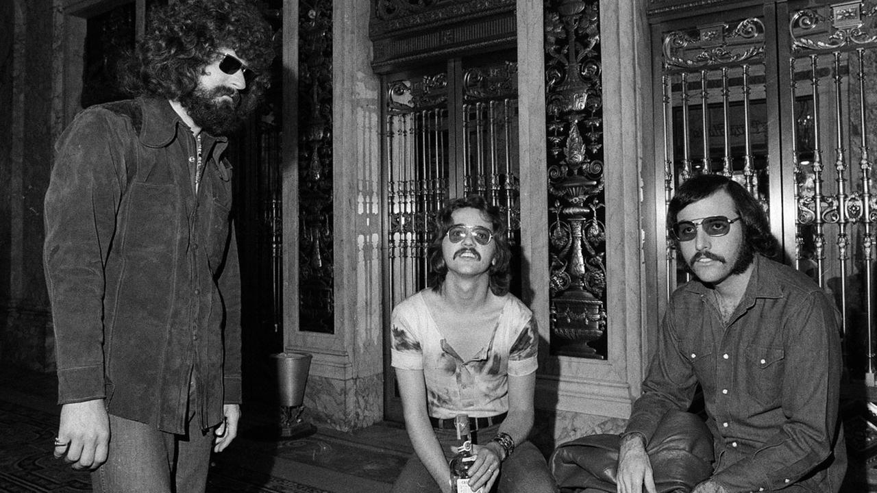 Members of the rock band Steppenwolf are seen, Aug. 25, 1970. Outside the Plaza Hotel in New York, from left to right: Goldy McJohn, Rushton Moreve and Jerry Edmonton.AP Photo/Marty Lederhandler