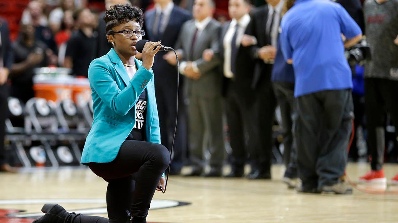 Denasia Lawrence sings the national anthem before an NBA preseason basketball game between the Miami Heat and the Philadelphia 76ers, Friday, Oct. 21, 2016 (AP Photo/Alan Diaz)