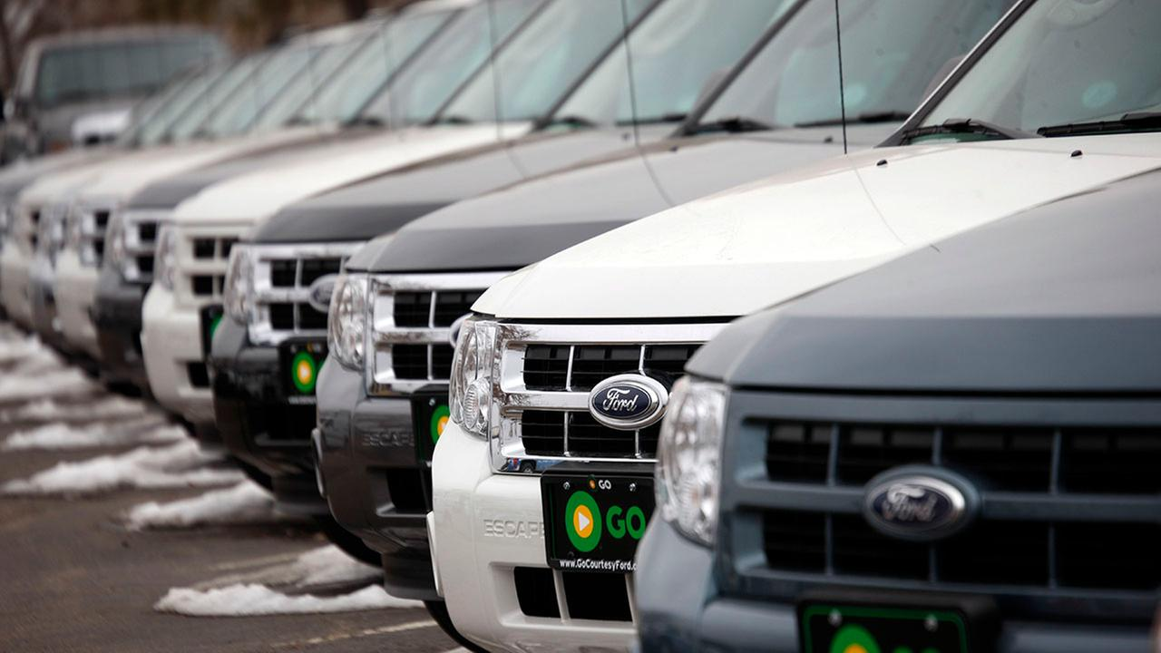 2010 Ford Escapes sit at a Ford dealership (AP Photo/David Zalubowski)