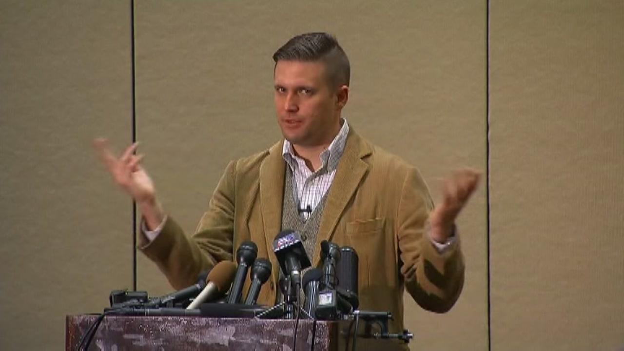 Richard Spencer talks to the media before his event in Texas A&M.