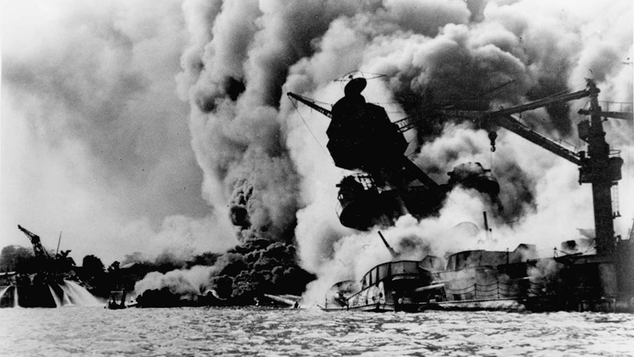 This photo shows the Japanese attack on Pearl Harbor on December 7, 1941. The USS Arizona is pictured in flames after the attack.