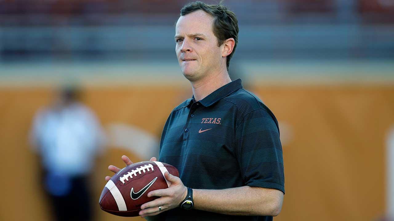 Major Applewhite directs warmups prior to an NCAA college football game against Kansas State, Saturday, Sept. 21, 2013, in Austin, Texas.