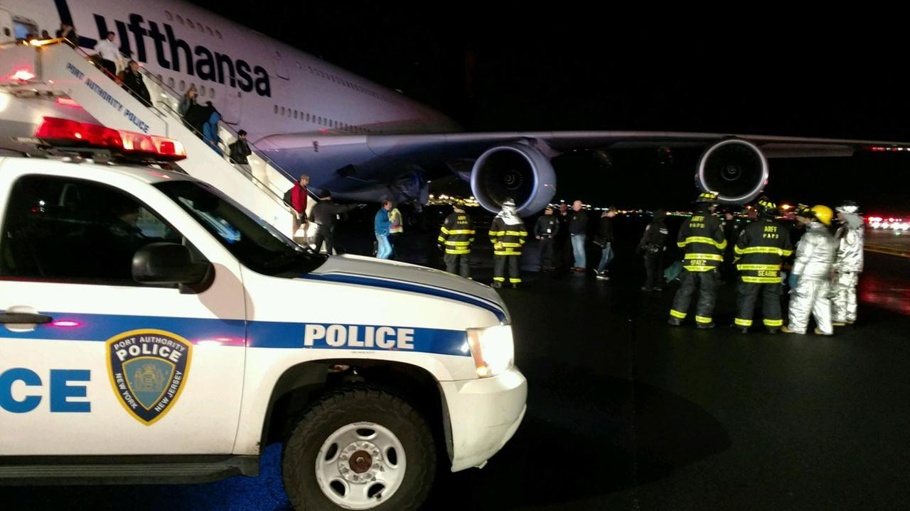 Passengers being led off a Lufthansa Airbus 380 by Port Authority Police patrol and ARFF units.
