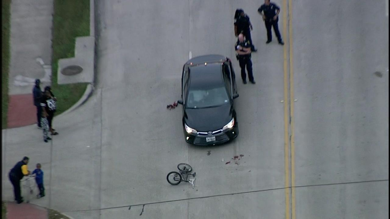 A child on a bike was hit by a car while crossing a street in northwest Houston.