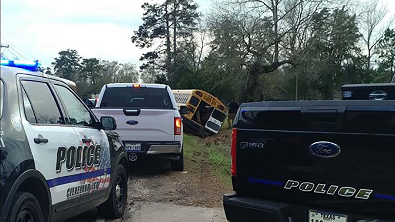 65 students taken to hospital after bus flipped over in ditch