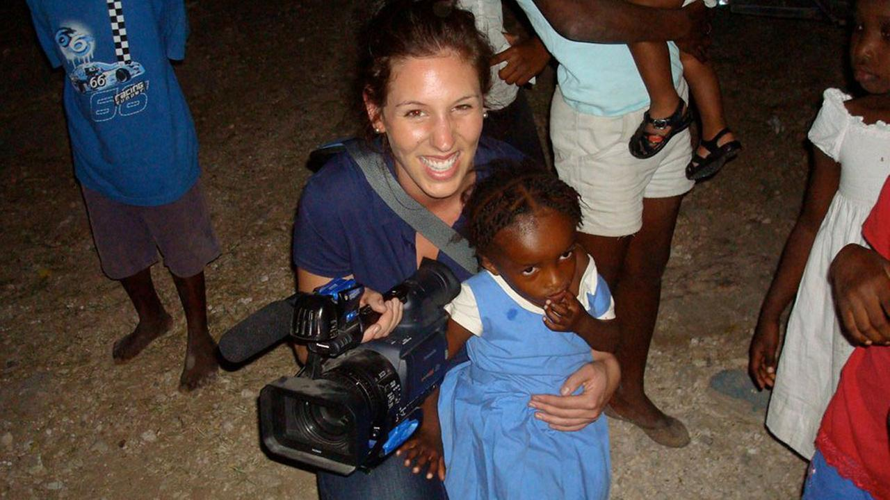 Courtney Fischer, as a reporter in Evansville, Indiana, covering the aftermath of the earthquake in Haiti.