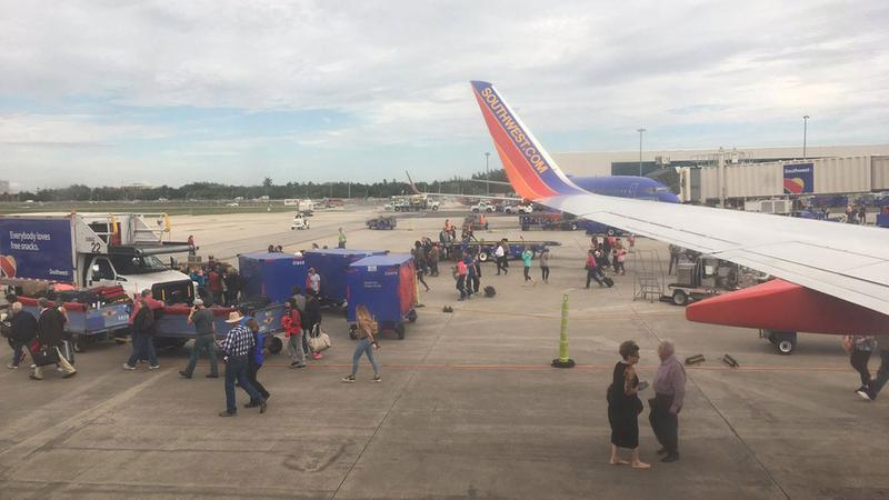 <div class='meta'><div class='origin-logo' data-origin='KTRK'></div><span class='caption-text' data-credit='Steve Campion'>Passengers stand on the tarmac following a shooting at Fort Lauderdale's airport.</span></div>