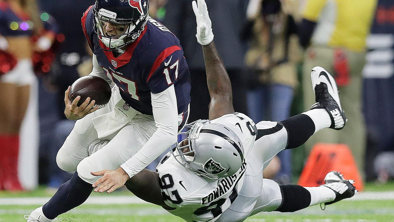 Houston Texans quarterback Brock Osweiler (17) scrambles for a first down against Oakland Raiders defensive end Mario Edwards (97).