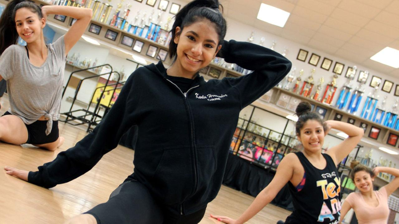 Sam Raybun High School senior Karla Hernandez practices with her dance team before the big day.
