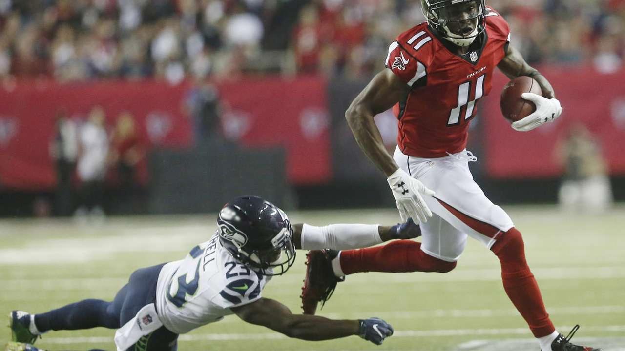 FILE - In this Saturday, Jan. 14, 2017 file photo, Atlanta Falcons wide receiver Julio Jones (11) runs past Seattle Seahawks free safety Steven Terrell (23)AP