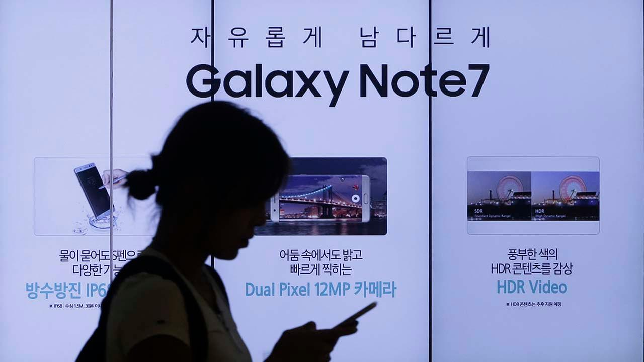 In this Sept. 2, 2016, file photo, a woman walks by an advertisement of Samsung Electronics Galaxy Note 7 smartphone at the companys showroom in Seoul, South Korea. Samsung Elect