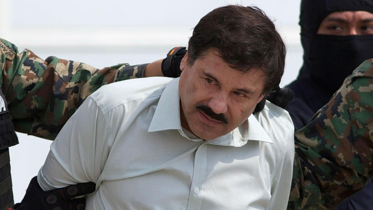 This Feb. 22, 2014 file photo shows Joaquin El Chapo Guzman, the head of Mexicos Sinaloa Cartel, being escorted to a helicopter in Mexico City following his capture.