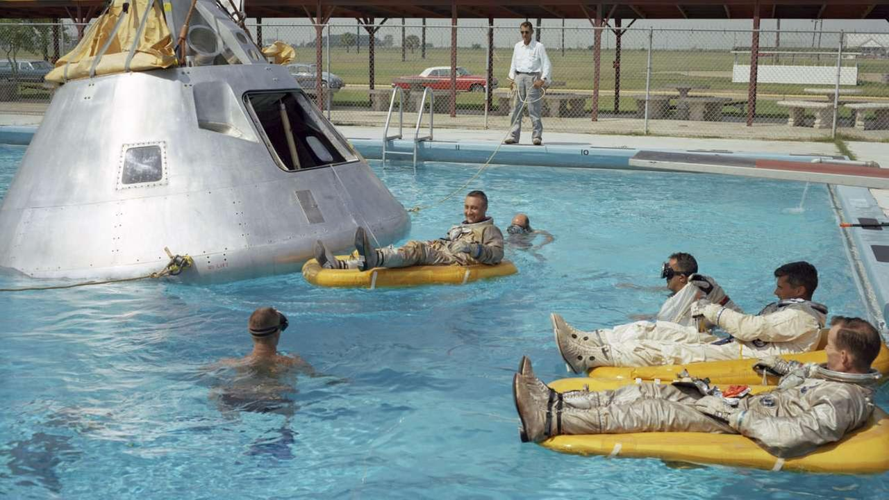In this June 1966 photo, the Apollo 1 crew practices water evacuation procedures with a full scale model  at Ellington AFB, near the then-Manned Spacecraft Center, Houston.AP