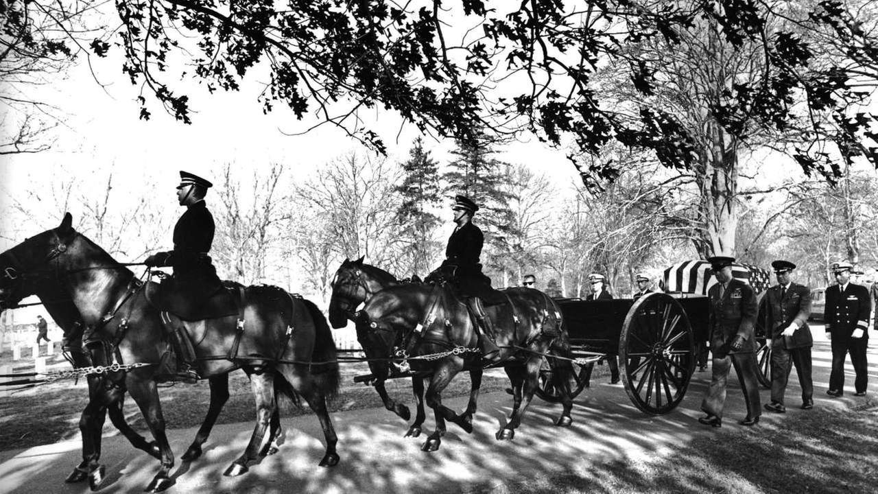 In this Jan. 31, 1967 photo, a horse-drawn caisson carrying the body of astronaut Virgil Grissom travels to the Arlington National Cemetery in Arlington, Va.AP