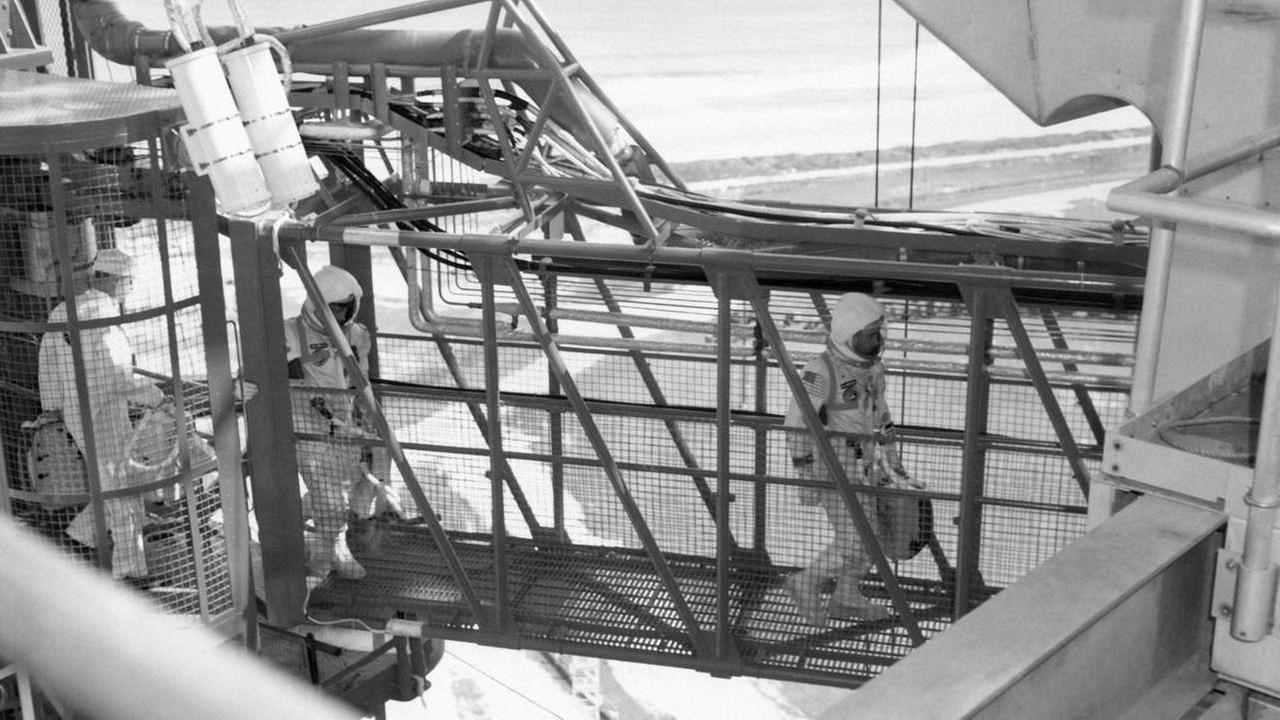 Jan. 27, 1967 astronauts Virgil Grissom, right, and Roger Chaffee walk across the ramp from gantry elevator to the Apollo I spaceship in Cape Kennedy, Fla., before a launch test.AP