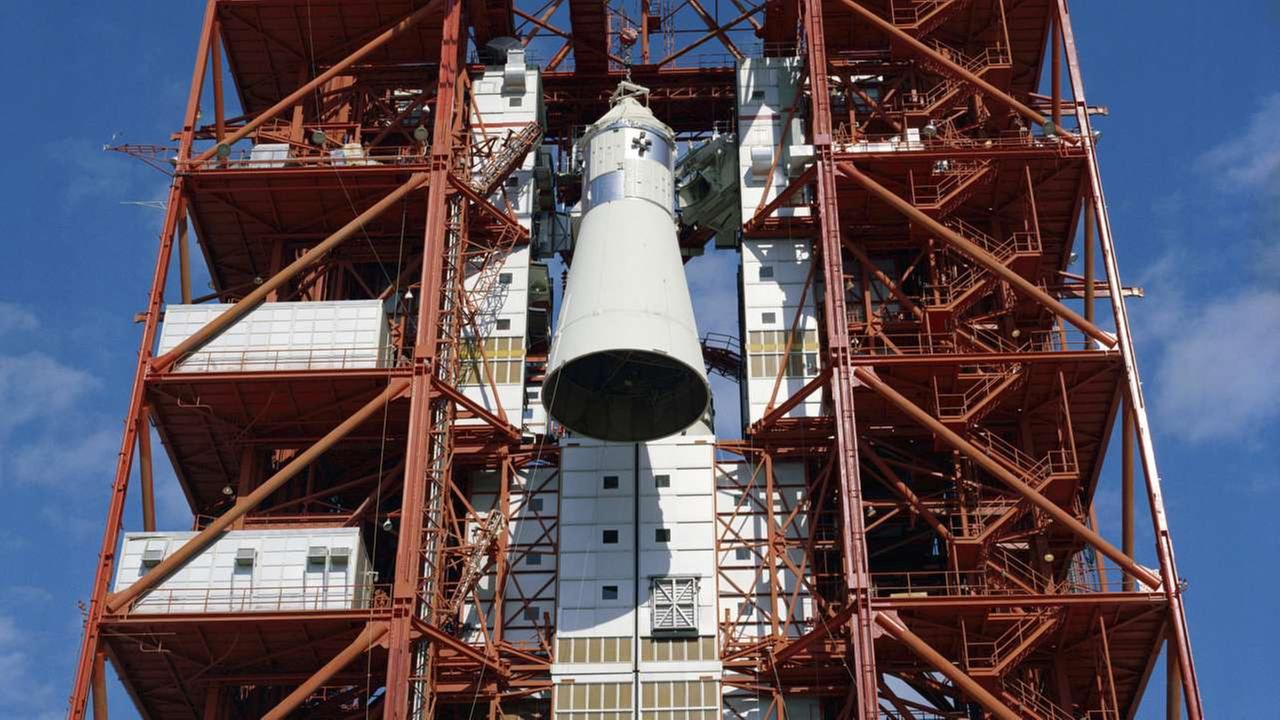 Apollo spacecraft is hoisted to the top of the gantry at Pad 34 at Cape Kennedy, Fla., for the Apollo/Saturn 204 mission.AP