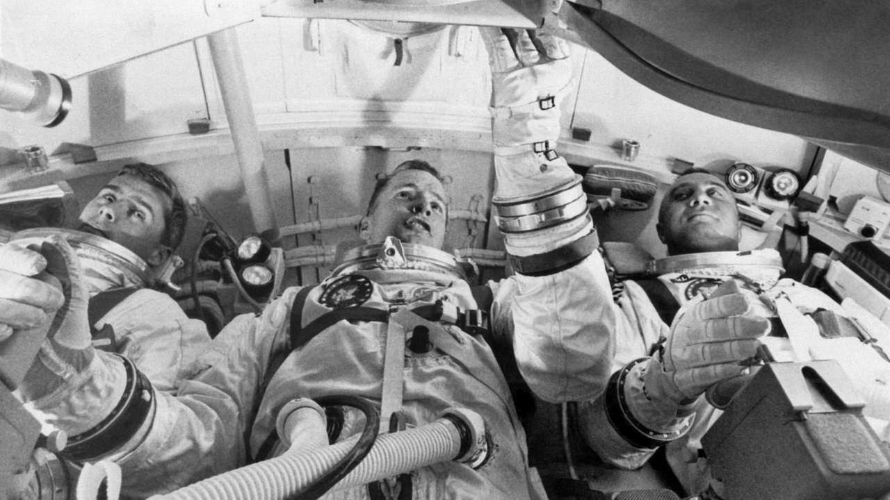 From left, astronauts Roger Chaffee, Edward White II, and Virgil Grissom, practice for their launch test in the Apollo Mission Simulator at Cape Kennedy, Fla.AP