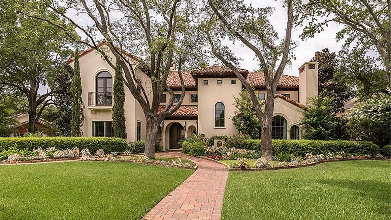 This refined Santa Barbara-style home in west Houston sold for $6 million. It boasts 5 fireplaces, a master with library, bedrooms with fireplaces, a steam shower and a pool. Houston Association of Realtors