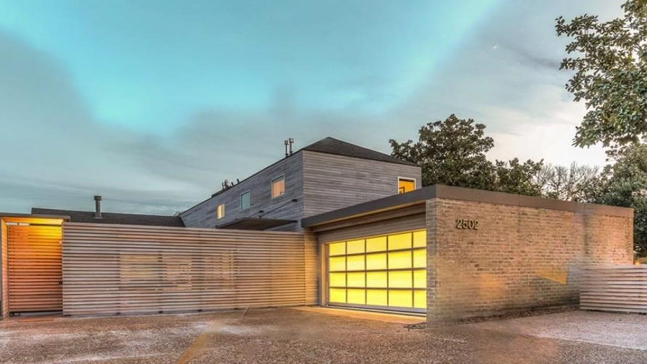 Beautiful, sleek, contemporary home on a golf course, is on the market