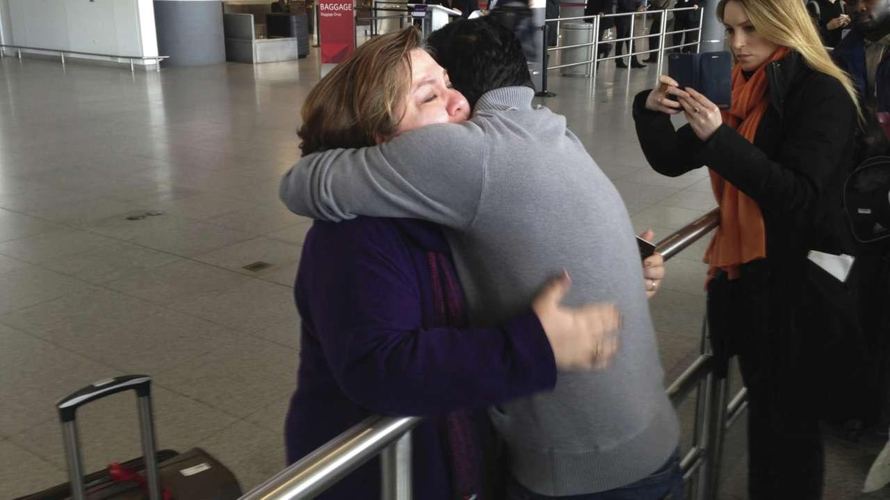 A woman is embraced by her son-in-law at John F. Kennedy International Airport on Sunday, Jan. 29, 2017, in New York.AP