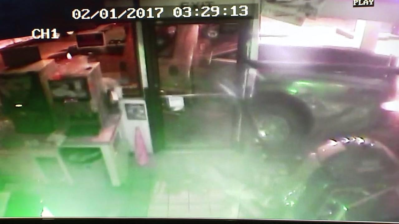 Surveillance video of smash and grab at southwest Houston gas station