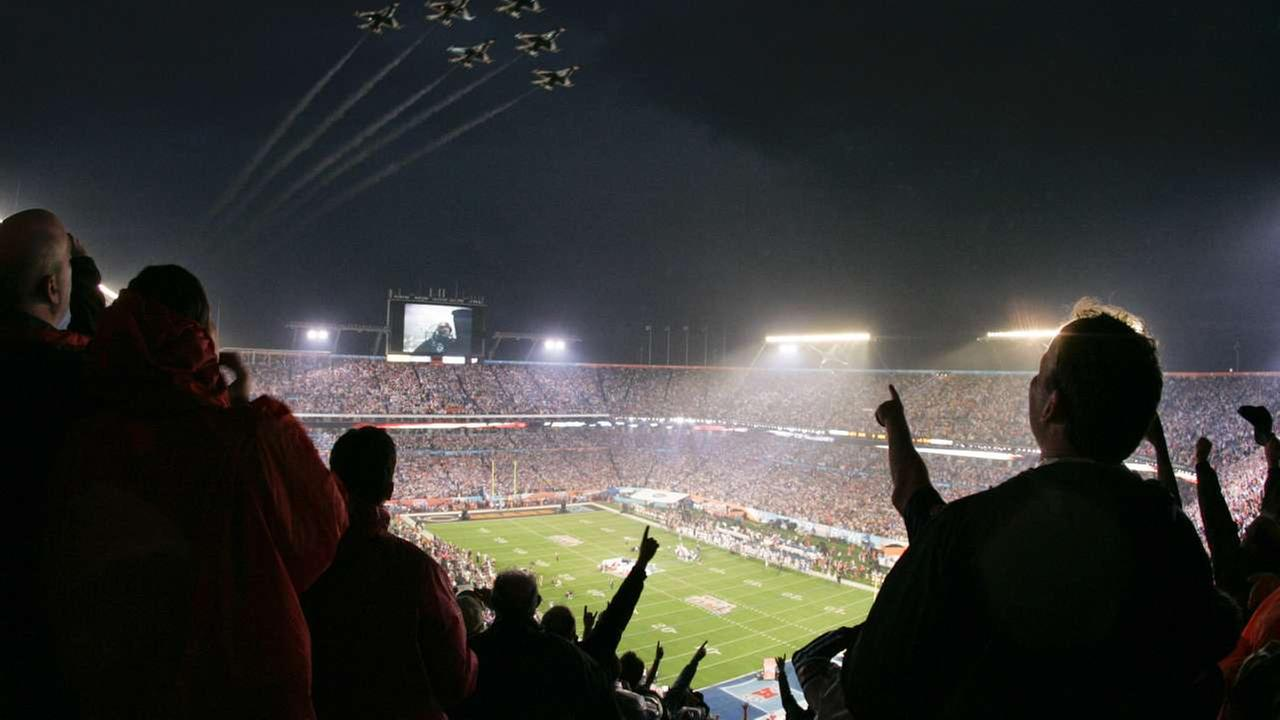 2007 - Fans watch the Air Force Thunderbirds fly over Dolphin Stadium before the Super Bowl XLI football game at in Miami, Sunday, Feb. 4, 2007. (AP Photo/Julie Jacobson)AP