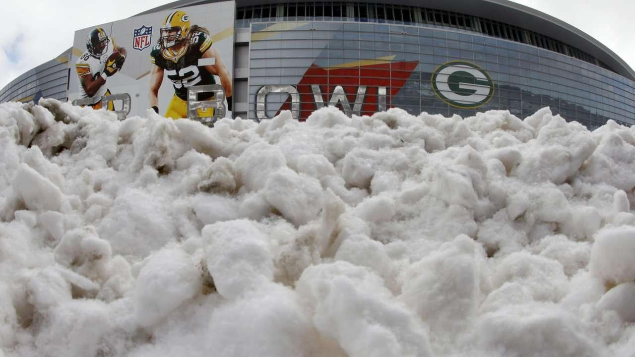 2011 - Cowboy Stadium, site of NFL football Super Bowl XLV, rises beyond a pile of snow Friday, Feb. 4, 2011, in Arlington, Texas.ASSOCIATED PRESS