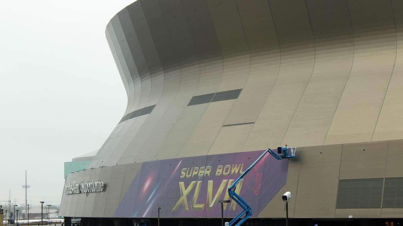 2013 - A person works on the Super Bowl sign at the Superdome in New Orleans on Monday, Jan. 14, 2013 for Super Bowl XLVII.AP