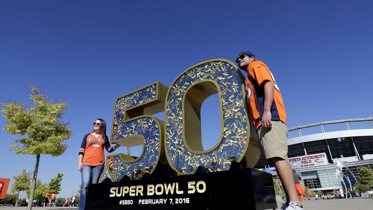 2016 - Broncos fans Dylan Garcia and Haley Merrigan pose with the Super Bowl 50 logo. Super Bowl 50 was held in Santa Clara, Calif on Feb. 7, 2016. The Broncos beat the Panthers.AP