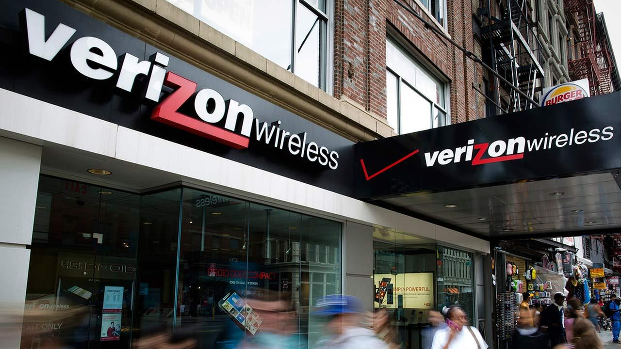 Pedestrians pass a Verizon Wireless store on Canal Street in New York.