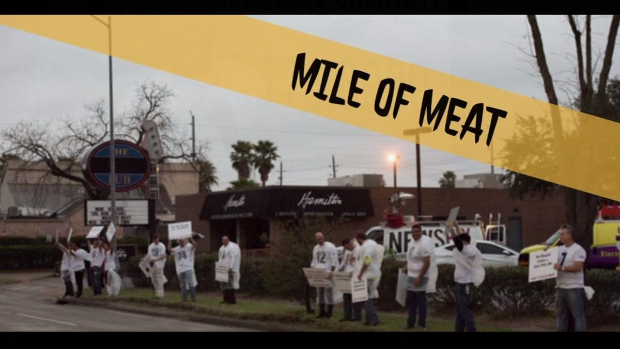 Eligible bachelors take to the streets on Valentines Day for the annual Mile of Meat in hopes of finding a date.