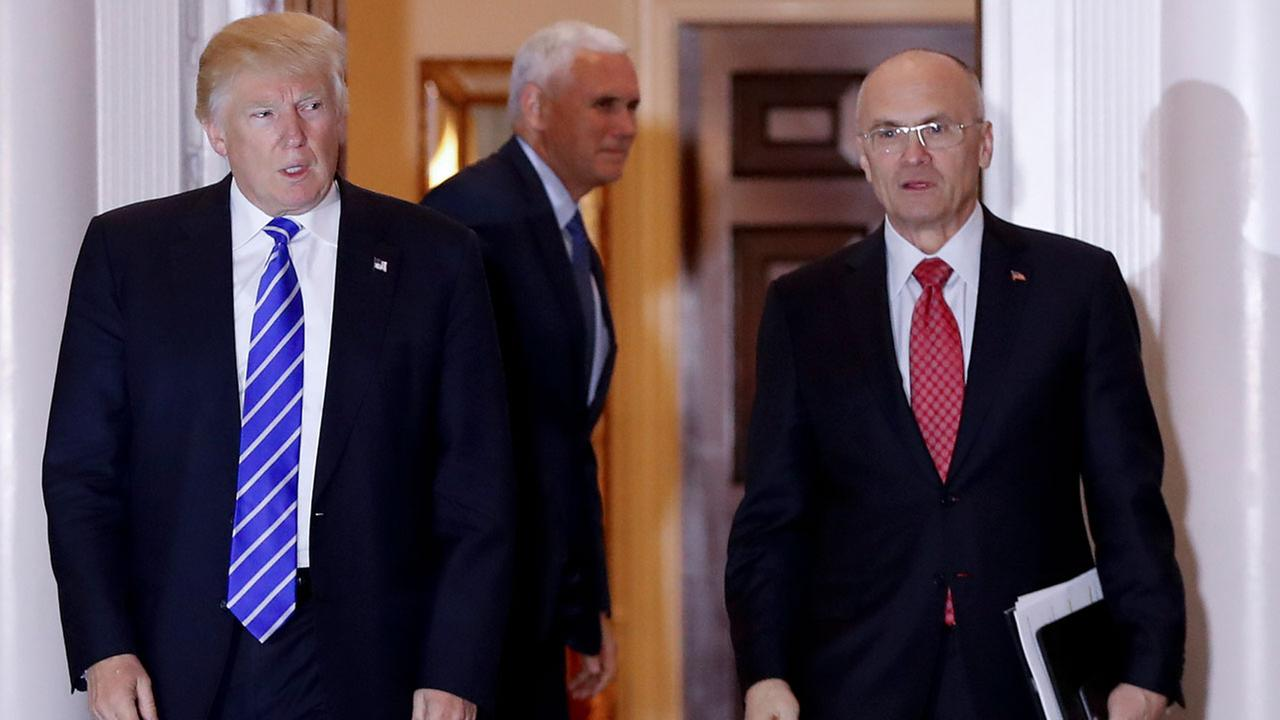 Then-President-elect Donald Trump walks Labor Secretary-designate Andy Puzder from Trump National Golf Club Bedminster clubhouse in Bedminster, N.J.