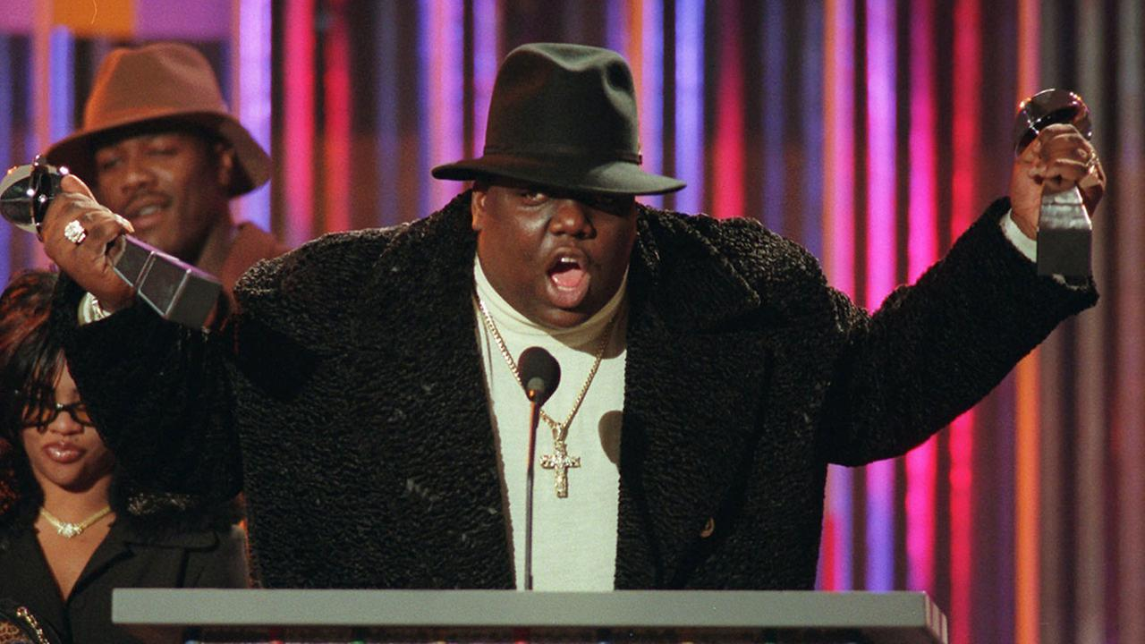 FILE - In this Dec. 6, 1995, file photo, The Notorious B.I.G., who won rap artist and rap single of the year, clutches his awards at the podium during the annual Billboard Music Aw