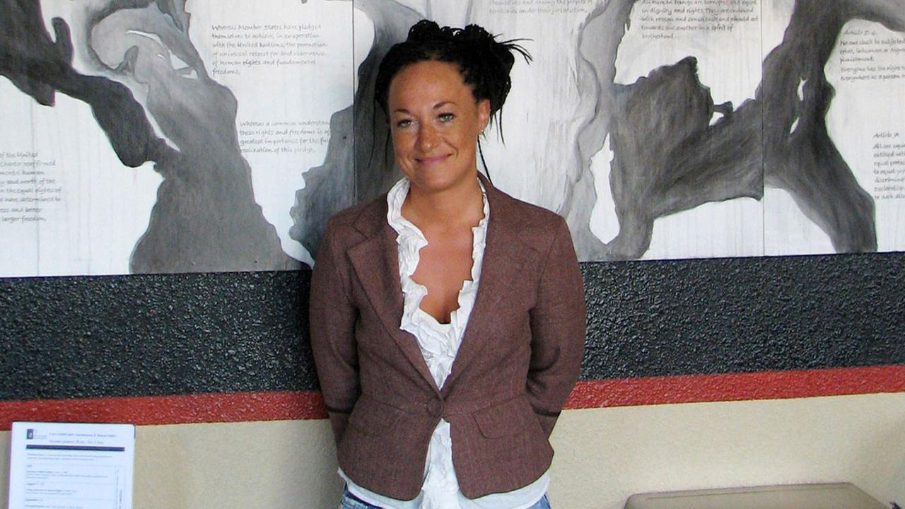 In this July 24, 2009, file photo, Rachel Dolezal, then a leader of the Human Rights Education Institute, stands in front of a mural she painted at the institutes Idaho offices.