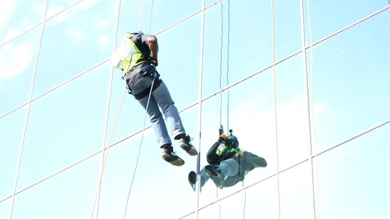 People rappel down a Houston building for charity in the Over the Edge event on Fri., March 3, 2017.
