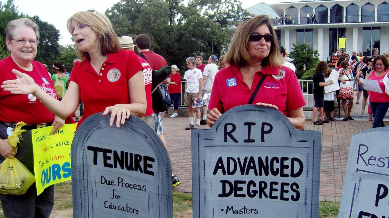 People gather outside the North Carolina General Assembly in Raleigh, NC during summer 2013 to protest the elimination of tenure and extra pay for teachers with advanced degrees