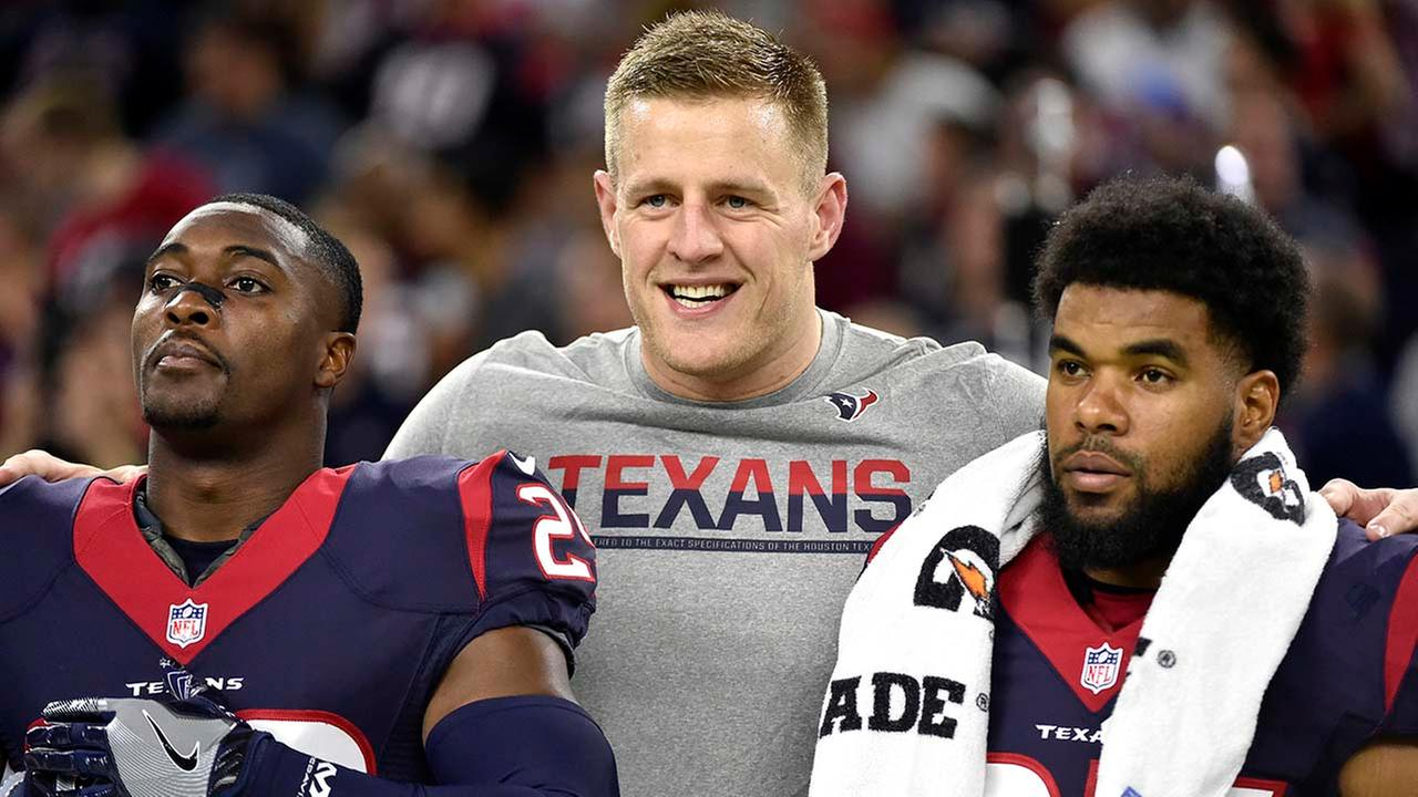 Houston Texans defensive end J.J. Watt, center, stands on the sidelines with teammates Andre Hal (29) and Quintin Demps (27) (AP Photo/Eric Christian Smith)