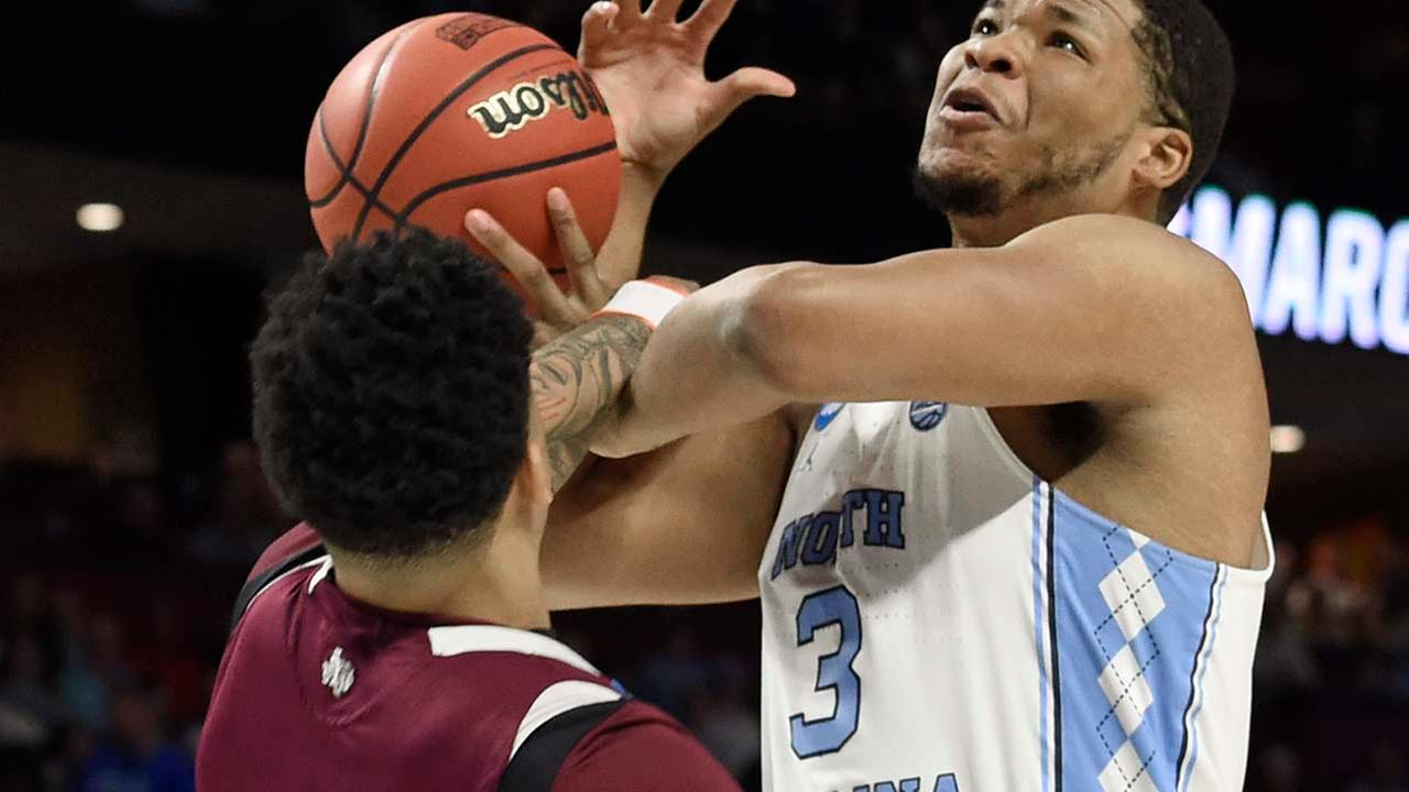 North Carolinas Kennedy Meeks (3) is fouled by Texas Southerns Zach Lofton (2) during the first half. (AP Photo/Rainier Ehrhardt)AP