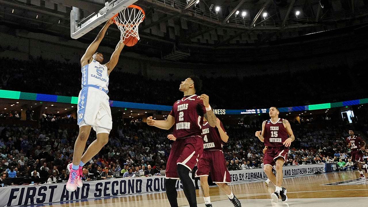 North Carolinas Tony Bradley (5) dunks against Texas Southerns Zach Lofton (2) during the first half. (AP Photo/Rainier Ehrhardt)AP