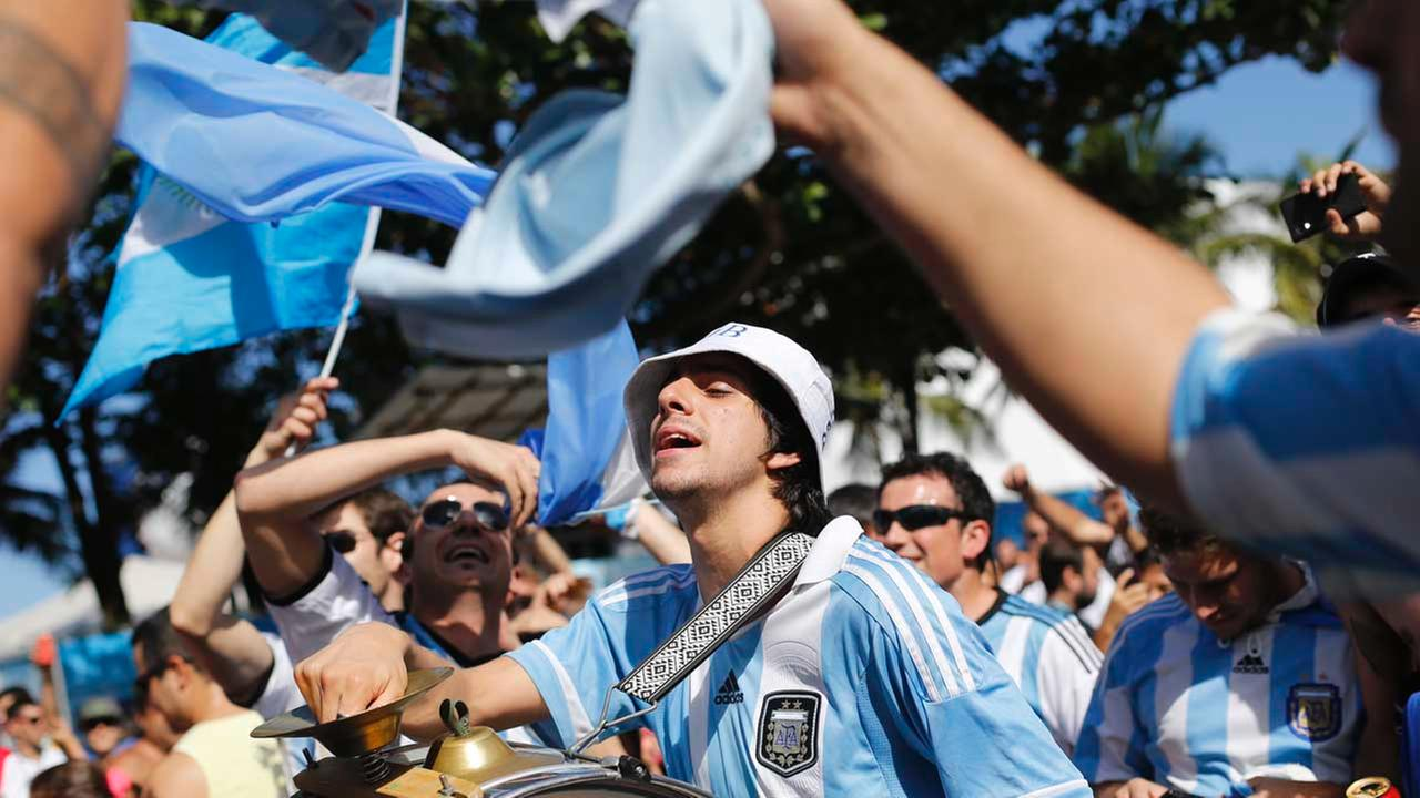 Argentina soccer fans sing and dance before the start of the final World Cup match between Argentina and Germany in Rio de Janeiro, Brazil, Sunday, July 13, 2014